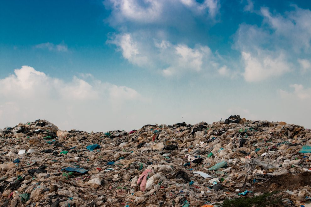 big garbage mountain with blue sky background